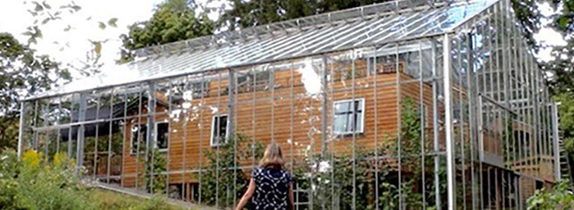 Couple Builds Greenhouse AROUND House to Grow Food and Keep Warm